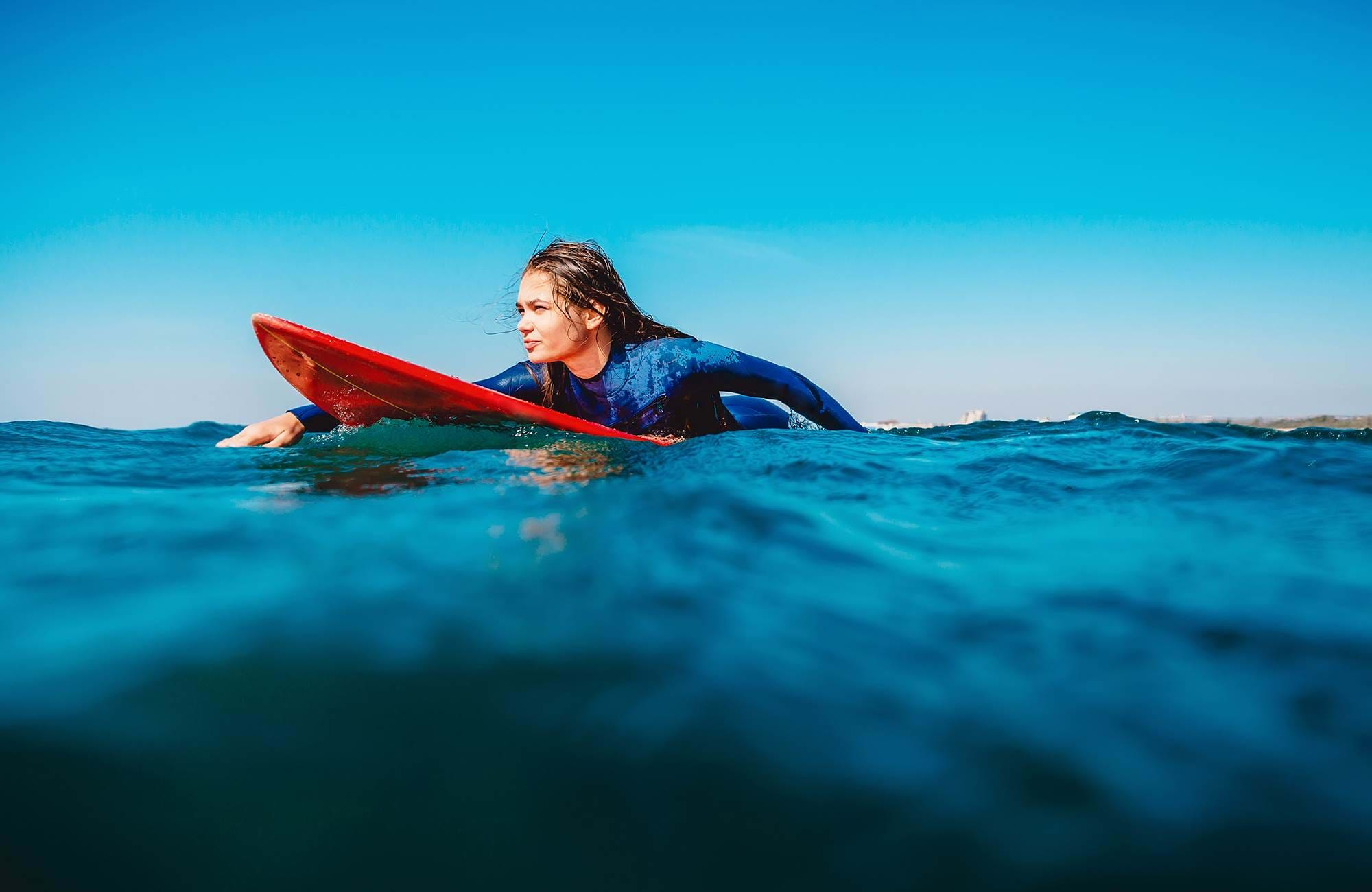 surfing-woman-paddling-calm-water-cover