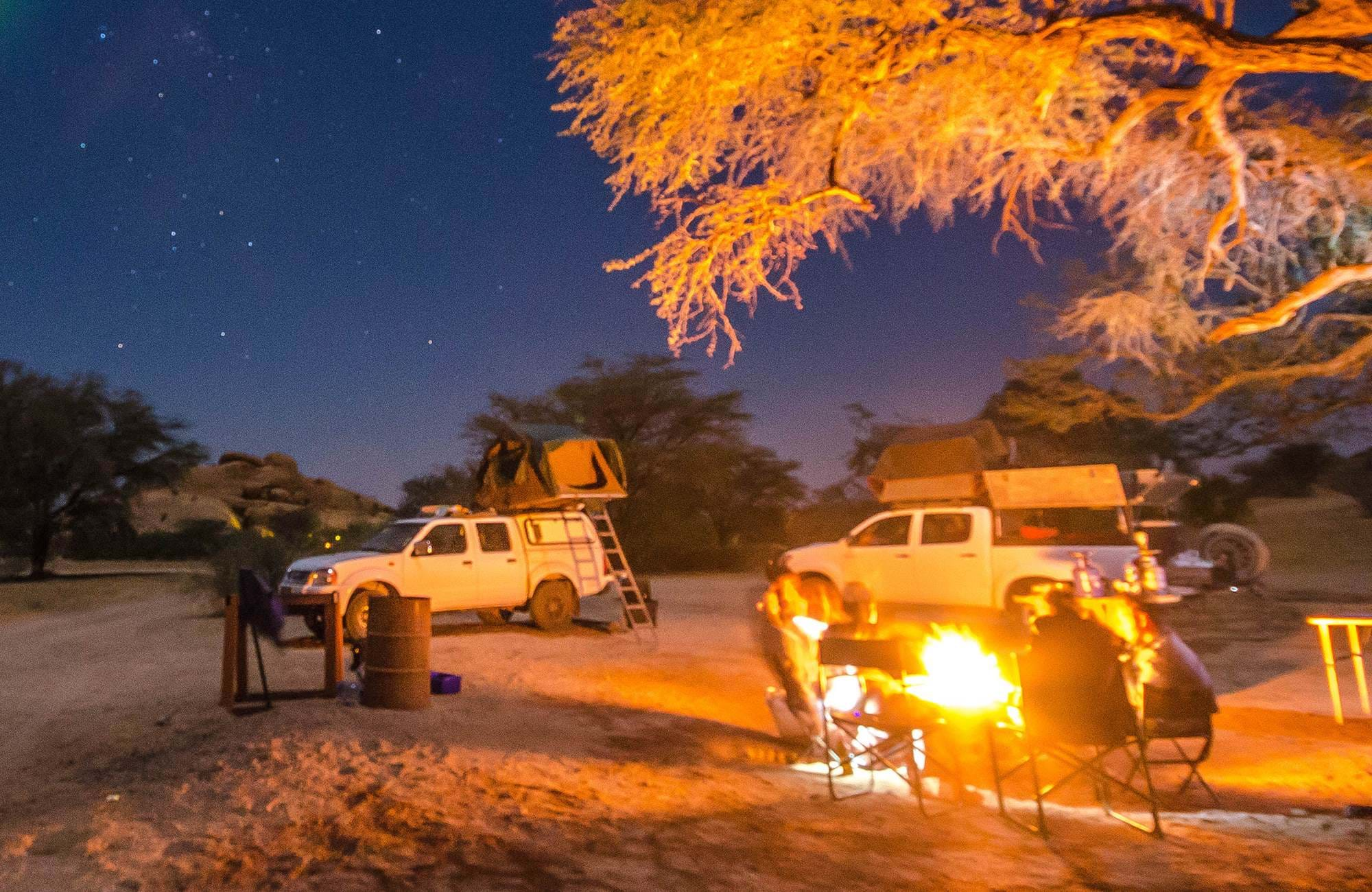 namibia-campervan-night-camp-bonfire-under-trees